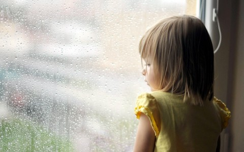 young girl looking from window; Shutterstock ID 81401887; PO: The Huffington Post; Job: The Huffington Post; Client: The Huffington Post; Other: The Huffington Post
